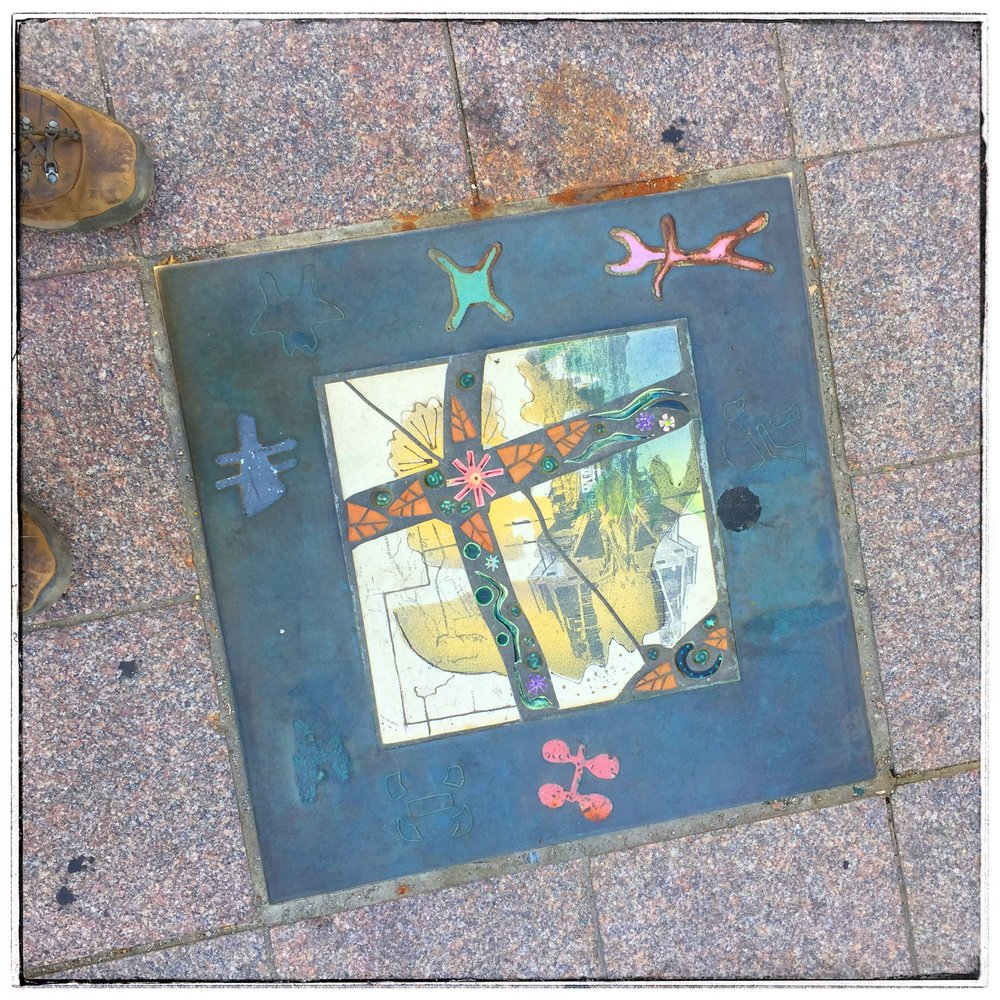 Salt Lake Street Art - Colorful tiles are embedded in the sidewalk to grab your attention and breakup what would be otherwise a drab concrete sidewalk.