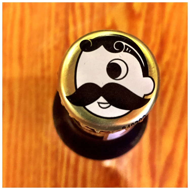 The iconic Natty Boh man still sits atop a bottle of beer.