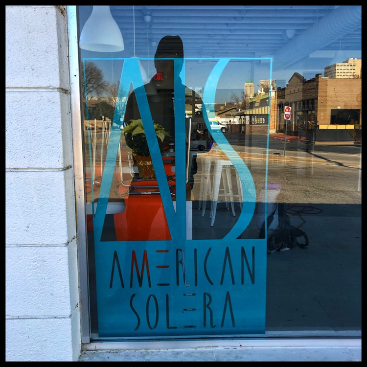 American Solera SOBO - My sad reflection having arrived several hours before opening and many hour after closing the night before.