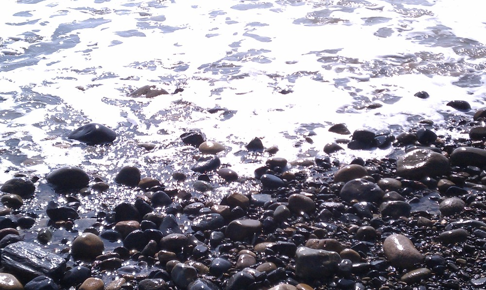 water lapping the pebble shore