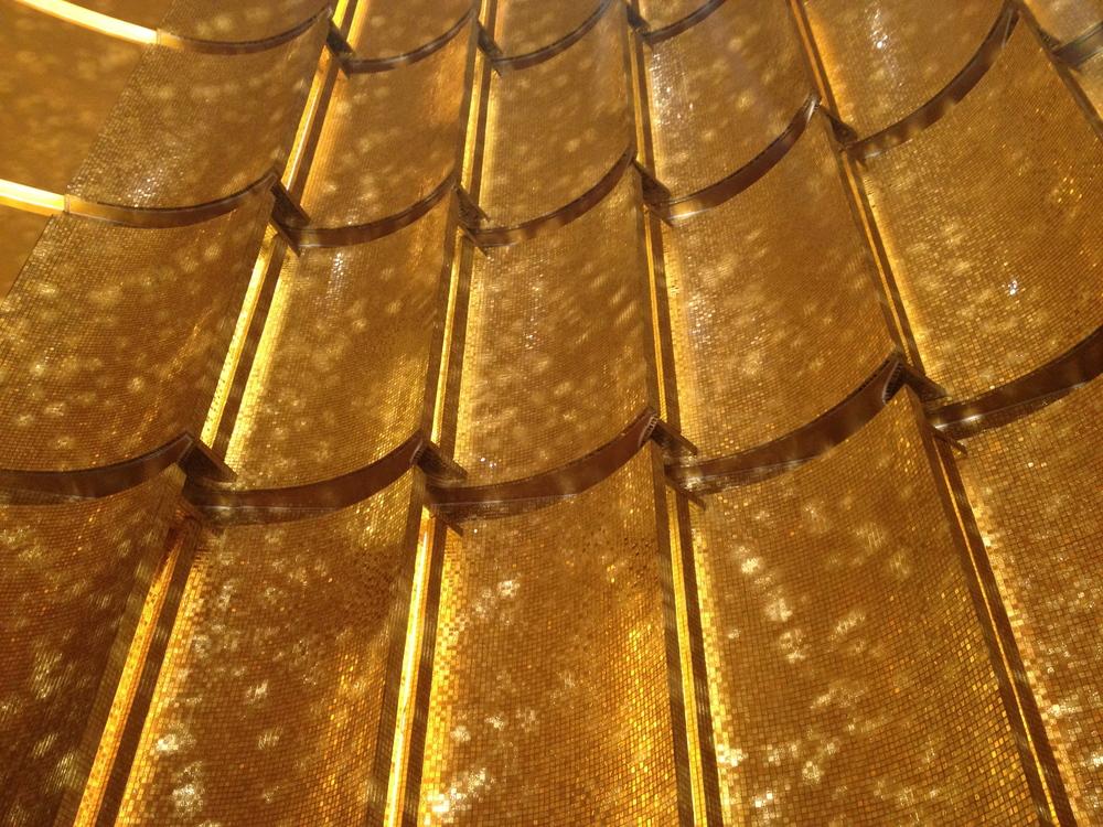 Gold detail at walls at MGM Macau
