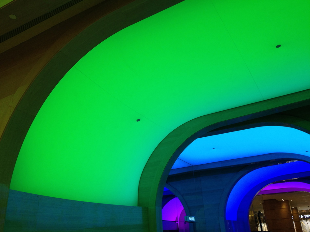 Shopping Arcade with color changing Illuminated archways at the MG Macau - detail