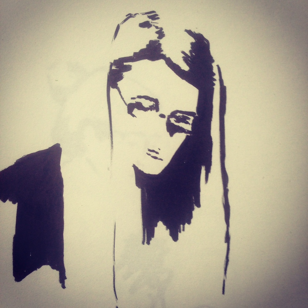 Ink sketch of a young woman studying