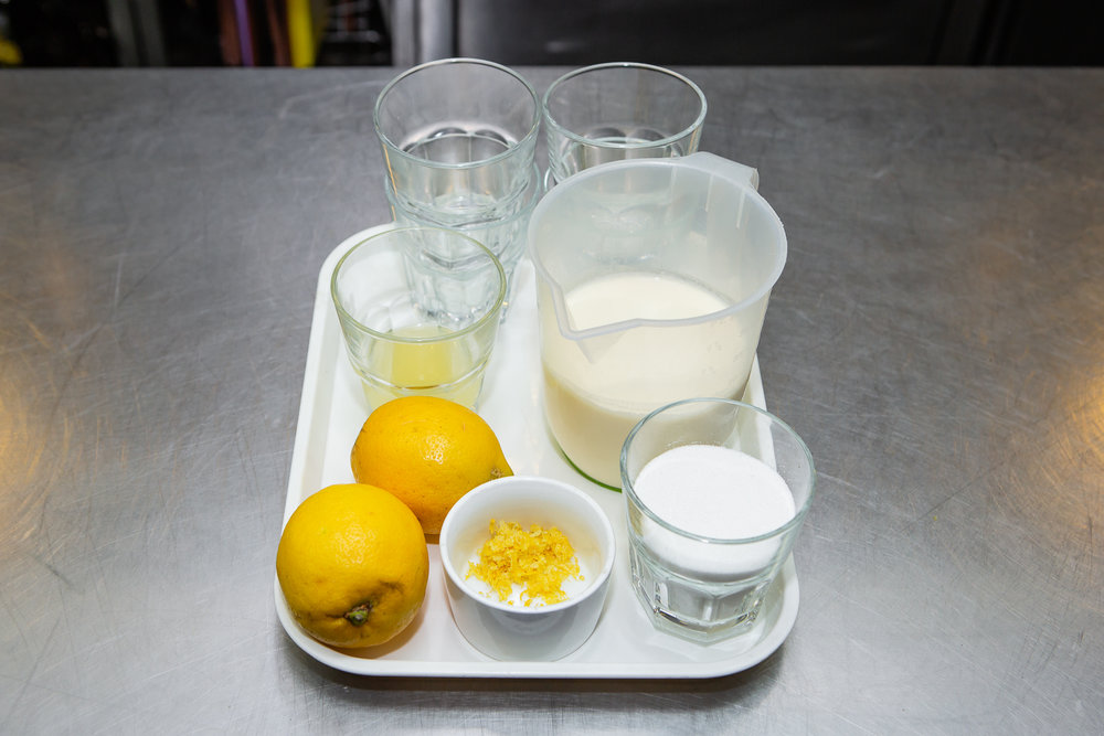 STEP ONE - Gather everything you need. 900ml double cream, 225g unrefined caster sugar, 2 organic lemons and 10 small glasses.