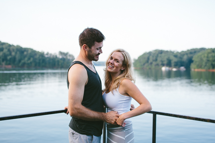 Happy Engaged Couple by the Water