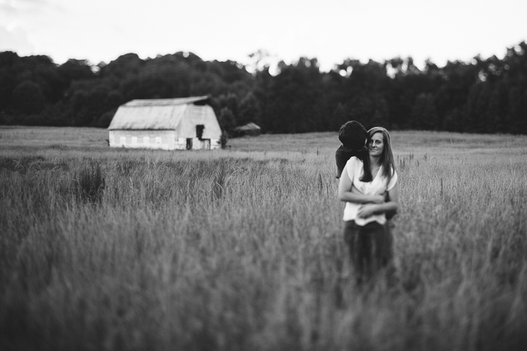 Black and White Shot of Couple in Field