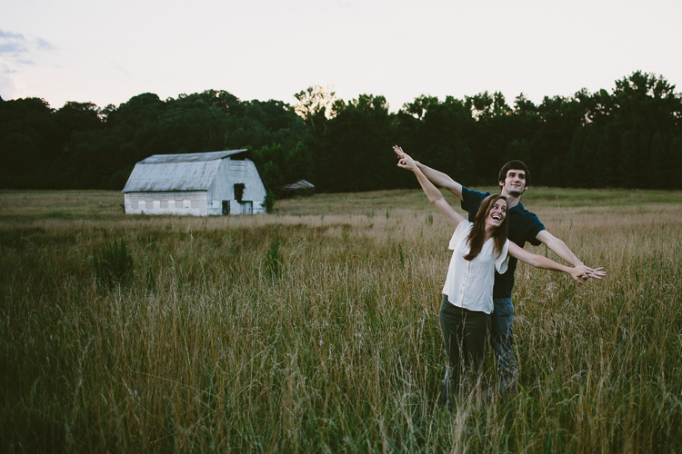 Playful Engaged Couple in Field