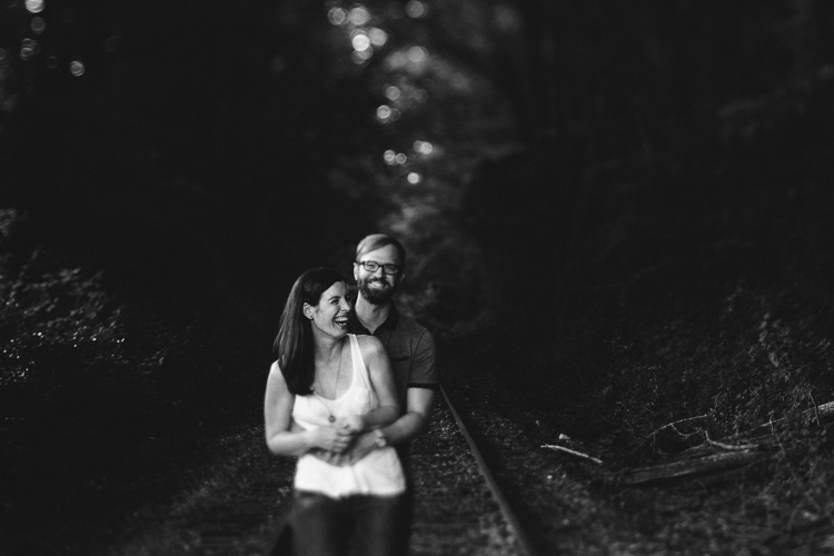 Black and White Shot of Couple on the Train Tracks