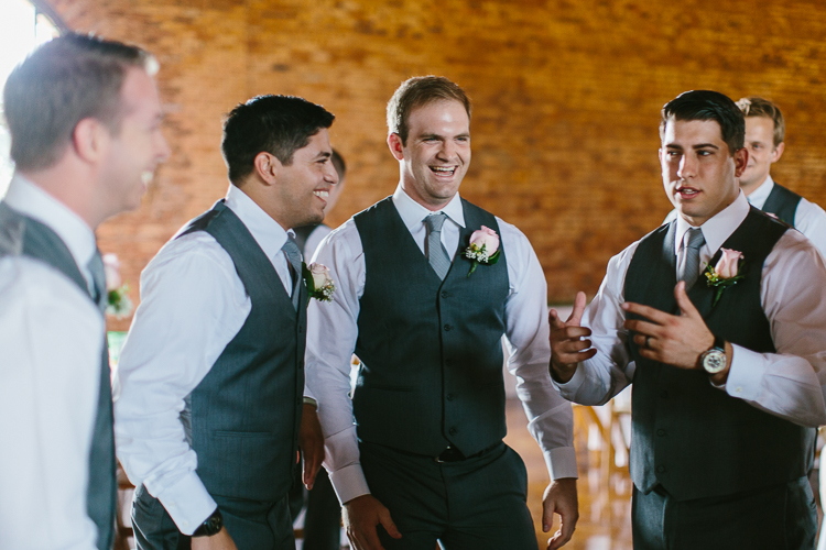 The Groomsmen Sharing Laughs