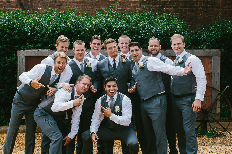 The Groom and Groomsmen Striking a Pose