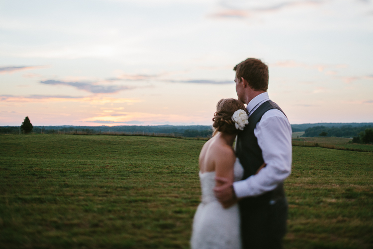 The Bride and Groom Admiring the Sunset