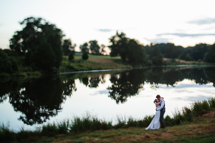 The Bride and Groom by Water with Reflection