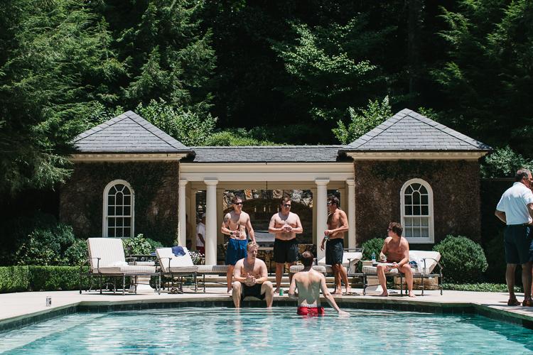 Groomsmen enjoying a few brews by the pool