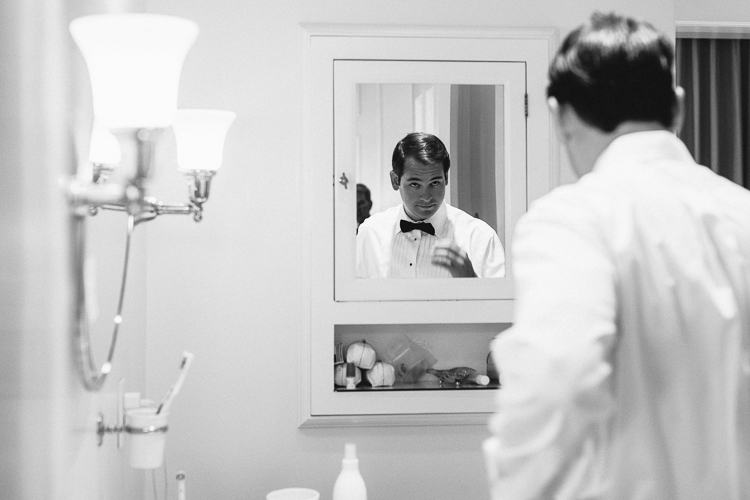 Black and white groom reflection portrait