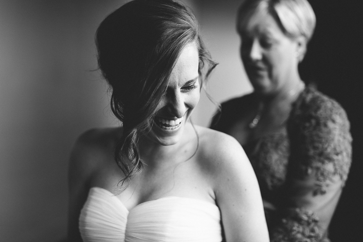 Black and white shot of bride getting ready