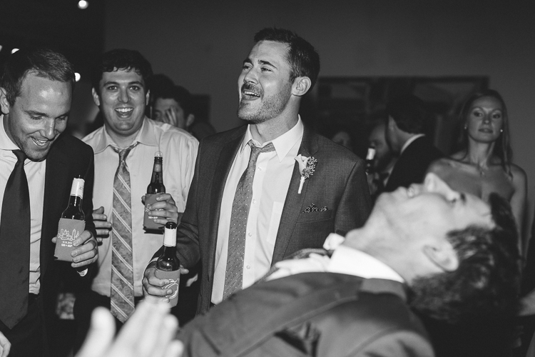 Groom and groomsmen dancing at reception