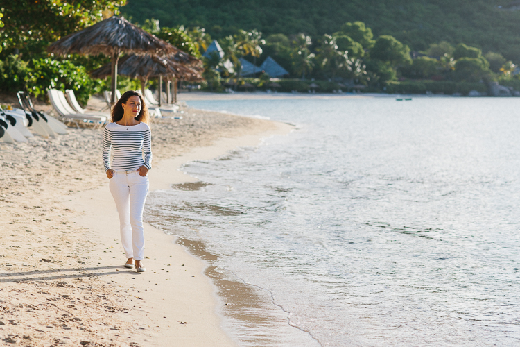 Lady walking down the beach of Virgin Gorda