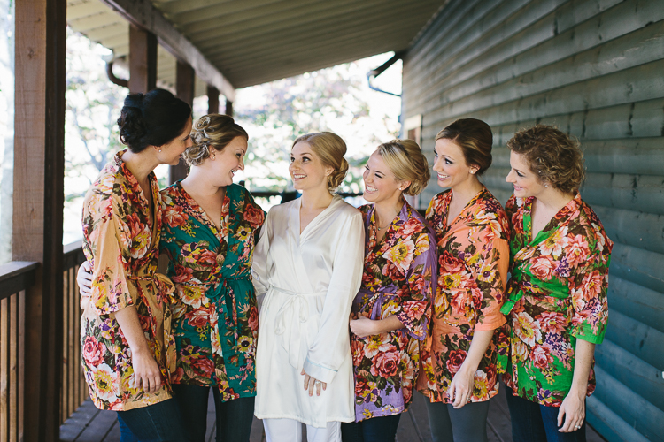 Bride and her bridesmaids getting ready in their floral robes