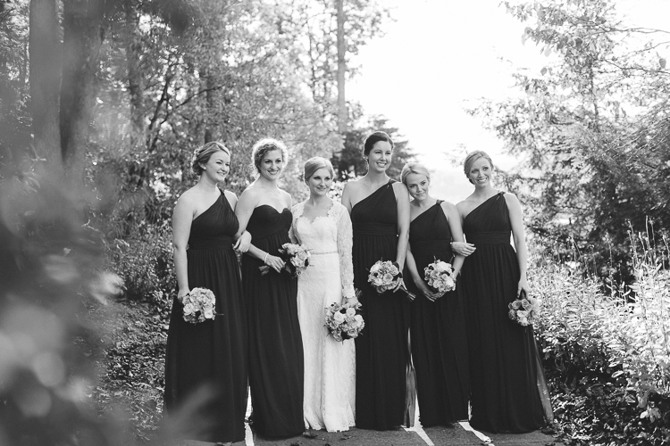 Black and white portrait of bride and her bridesmaids