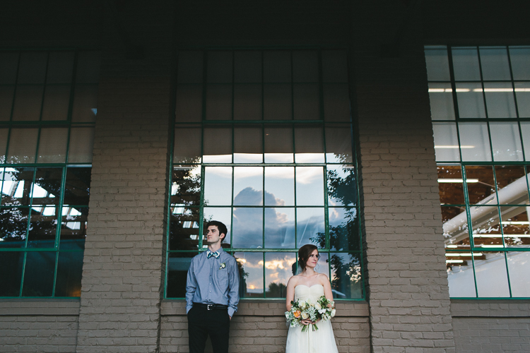 Bride and groom portraits with beautiful sky reflection