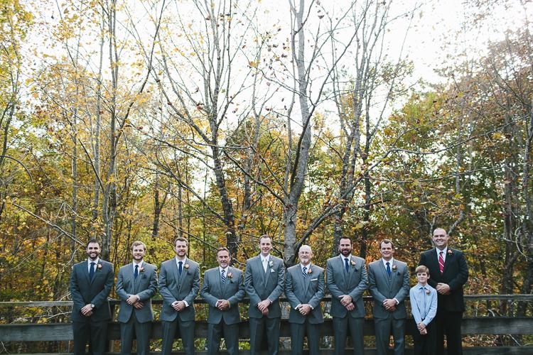 Groom and his groomsmen on bridge