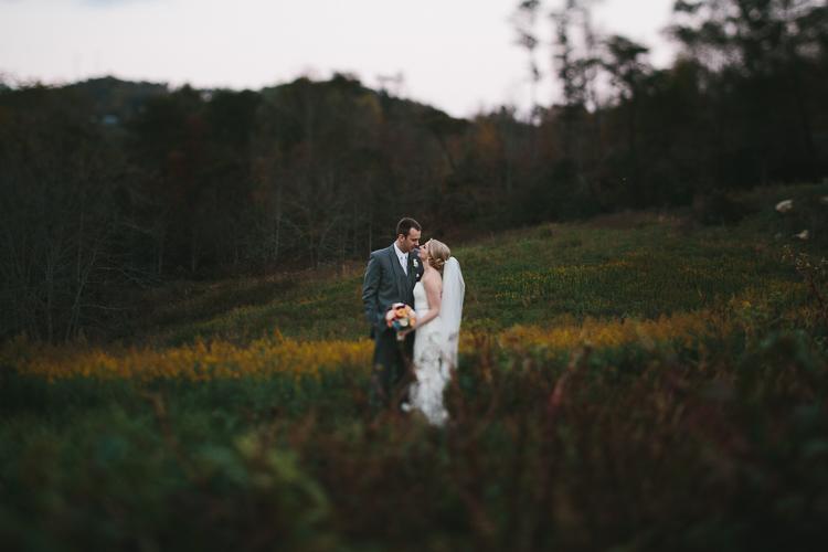 Bride and groom in golden rod field