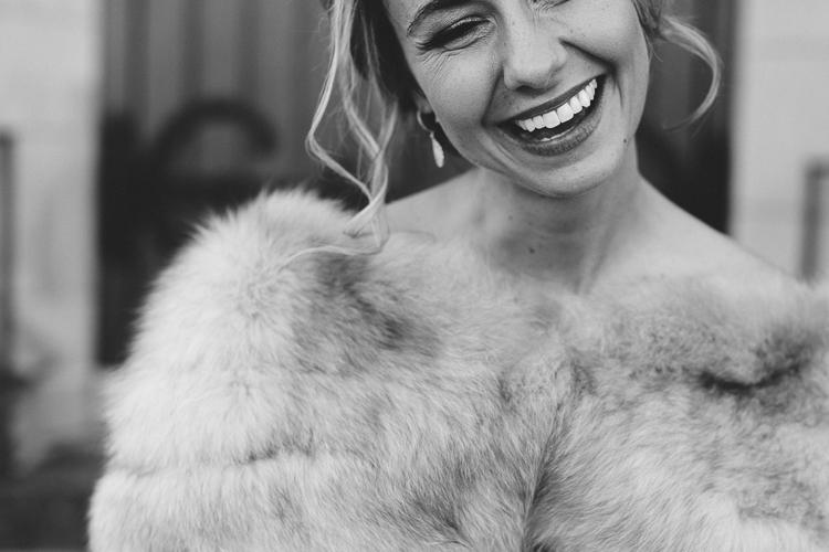 happy winter bride with her fur wrap