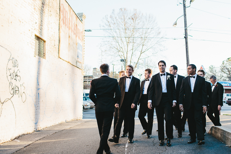 groom walking with his groomsmen