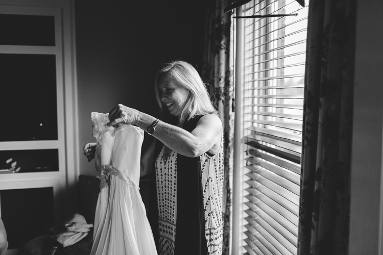 mother helping the bride get ready