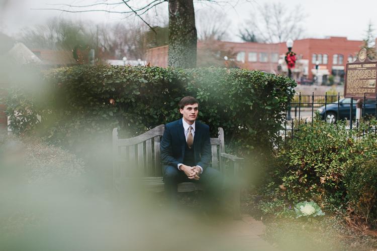 groom sitting on bench
