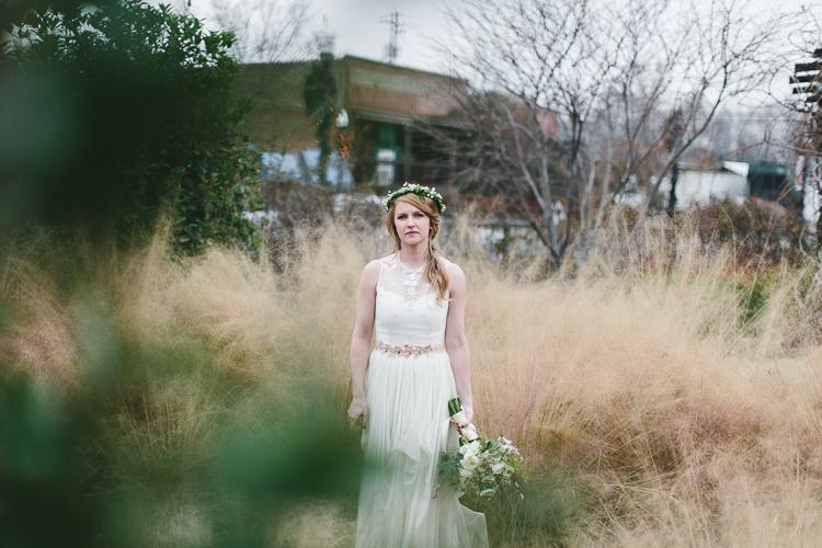 stunning shot of bohemian bride in tall grass