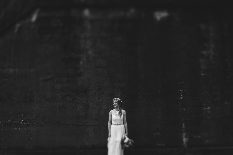 bohemian bride by concrete wall