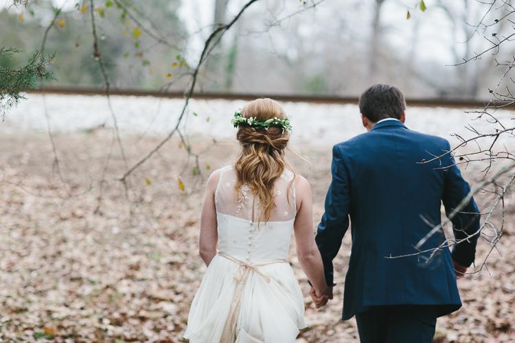 bride and groom walking from behind