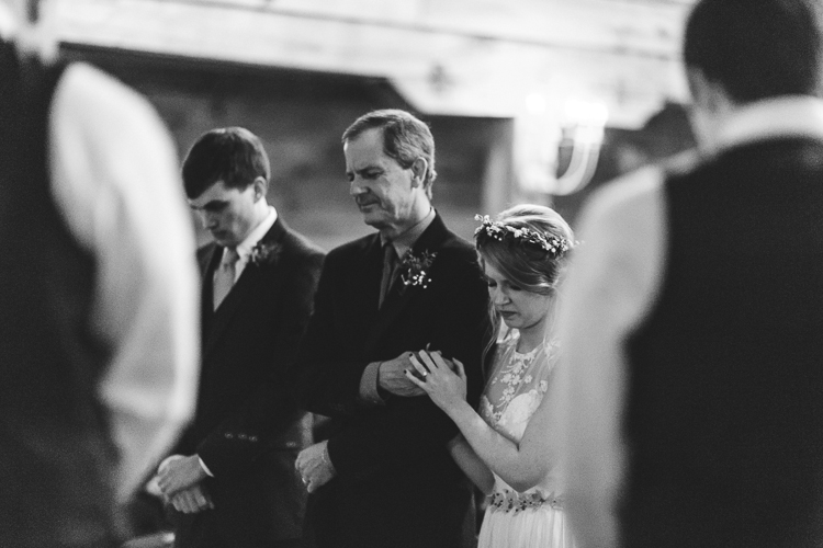 father gives away his daughter to her groom