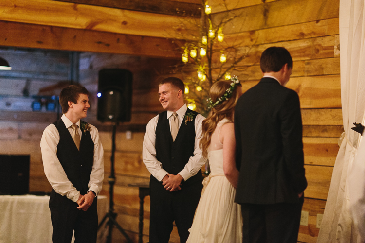 brothers share a smile while their sister gets married