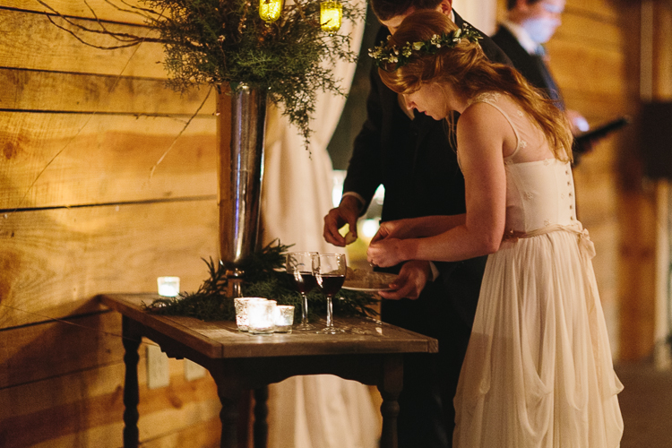 bride and groom taking communion during their wedding ceremony