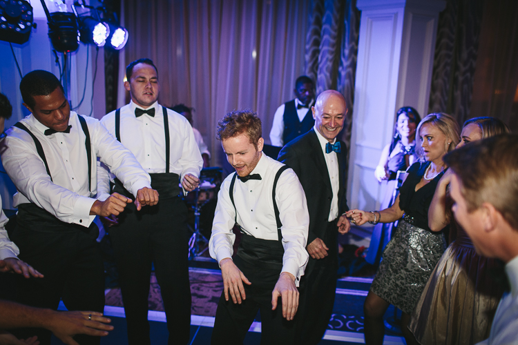 groomsmen dancing on the dance floor