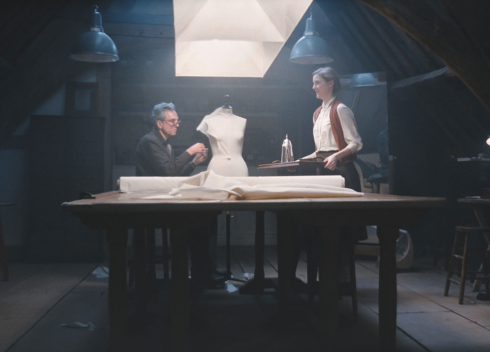 Alma (Vicky Krieps) visits Reynolds (Daniel Day-Lewis) in his workshop