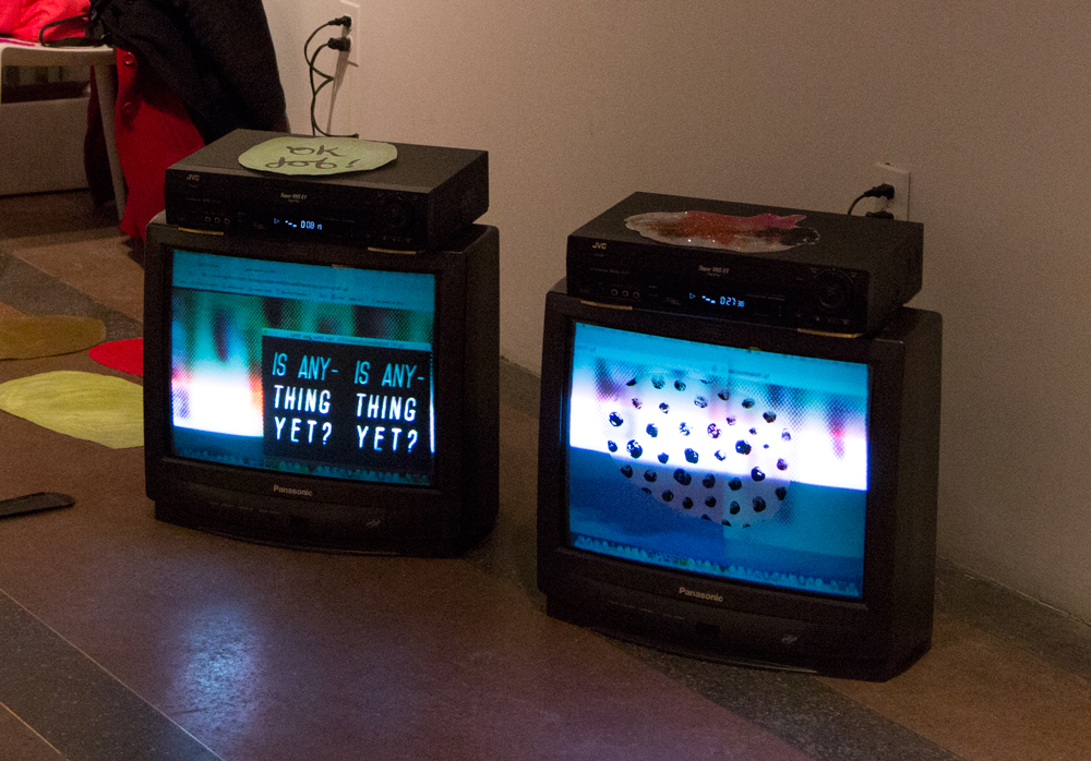 Documentation of   Is Anything Yet   animated gifs shown on box tv's with VHS players & interactive interface with static cling stickers 2015 Current Gallery - Baltimore, Maryland