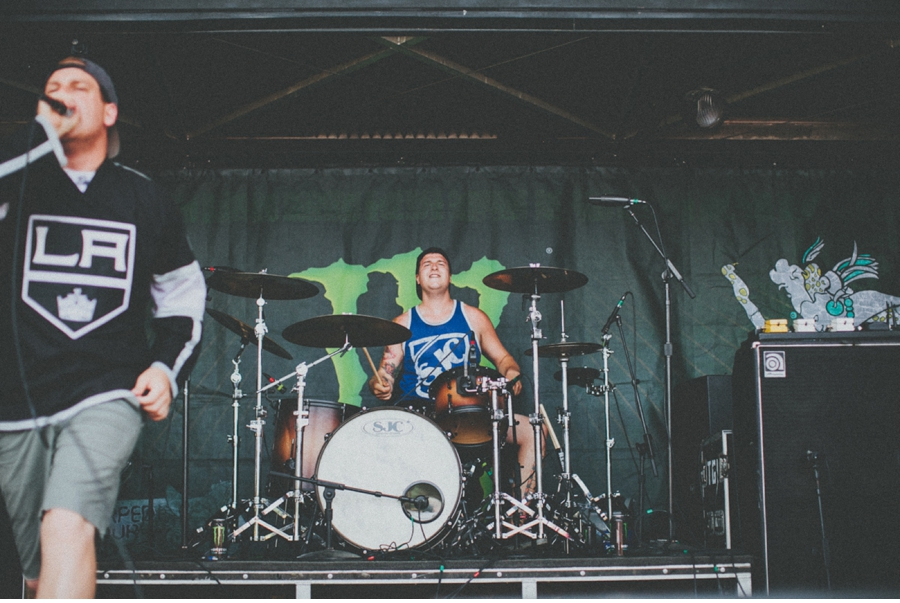 Drummer Andrew Tkaczyk plays on the Monster Energy stage at Vans Warped Tour 2012 in Dallas, Texas.