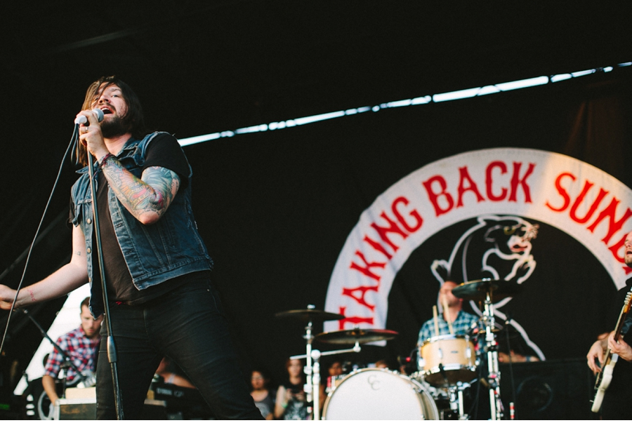 Adam Lazzara performs with Taking Back Sunday at Vans Warped Tour 2012 in Dallas, Texas.