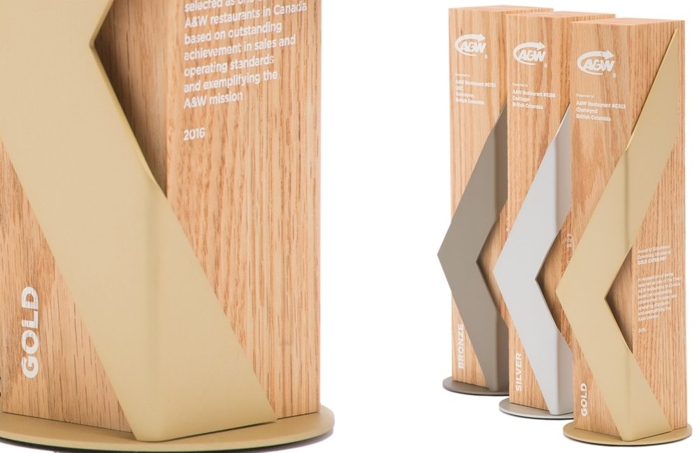 We designed this collection of awards for A&W Canada. Each award style represents a different achievement but, they all relate to each other by using the same design language (materials and typography). Creating a cohesive collection of awards is always a challenge but, we were able to deliver and exceed the clients expectations. These awards were all custom designed and handcrafted by us in our Vancouver location.jpg