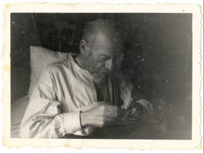 Korczak sewing  while sick in bed.