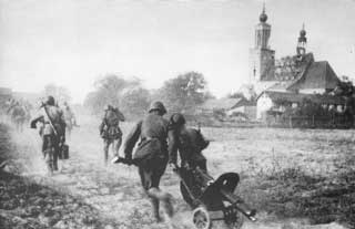 The Polish First Army reach Little Rose Summer Camp in 1944 and pass the steeple where Hitler looked out at Warsaw as it fell in 1939.