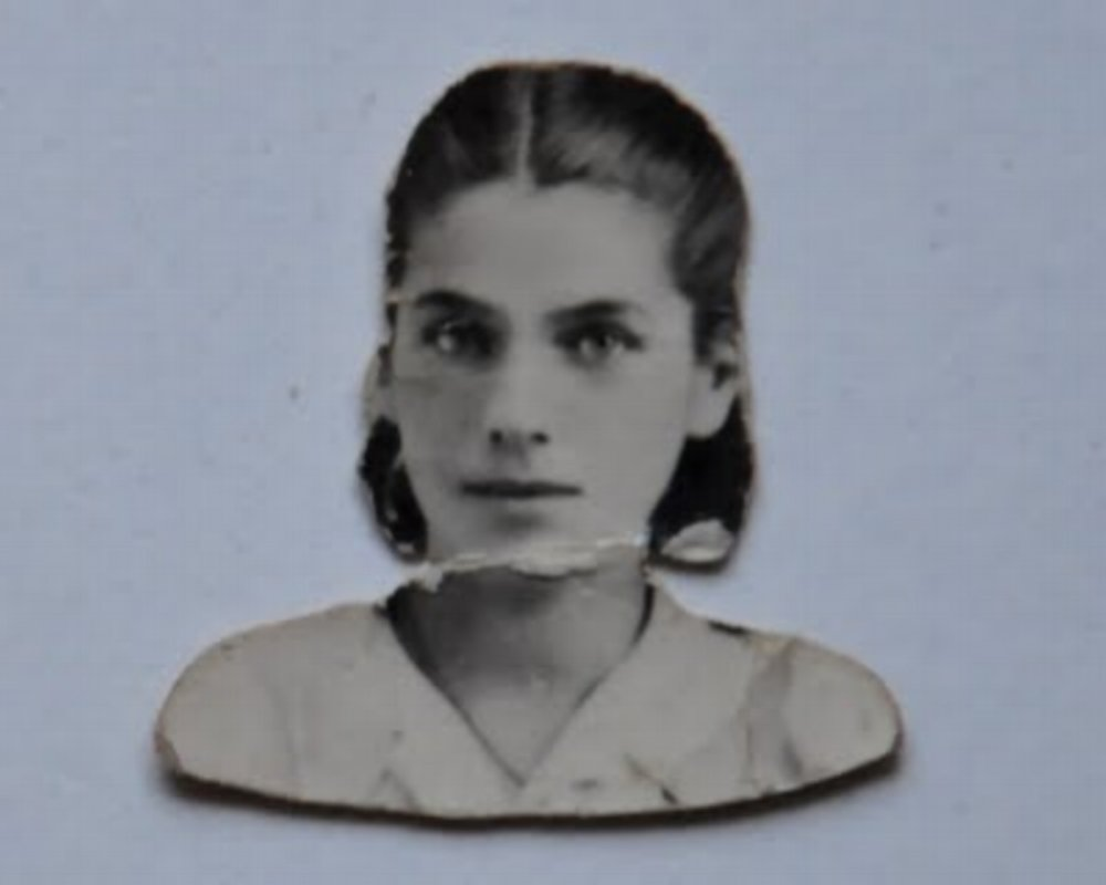 The photo of Sophia that Misha carried in his wallet, not knowing if she was alive, taken for her forged identity papers in the Warsaw ghetto.