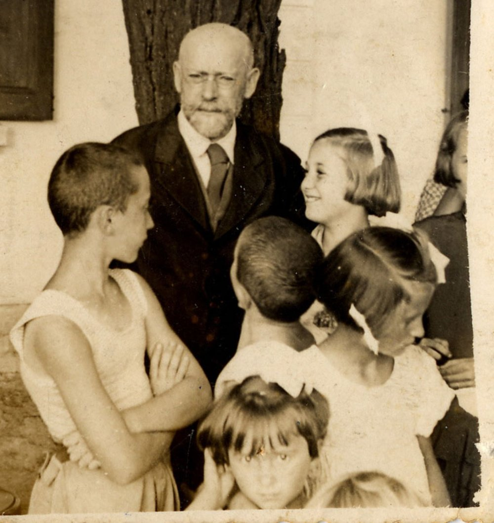 Dr Janusz Korczak and the children in the playground at the summer camp.