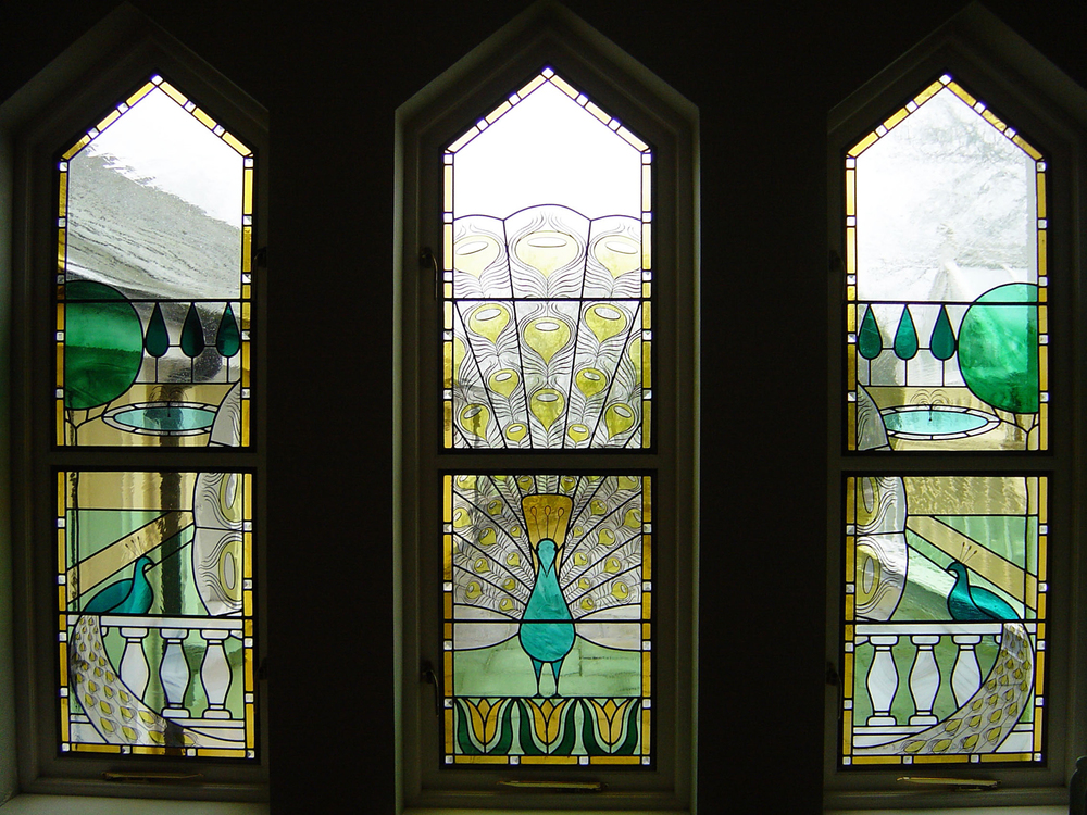 Peacock windows in hall, Caterham.