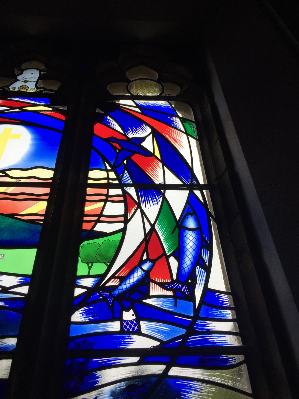 Stained glass jumping fish in Eridge Church window