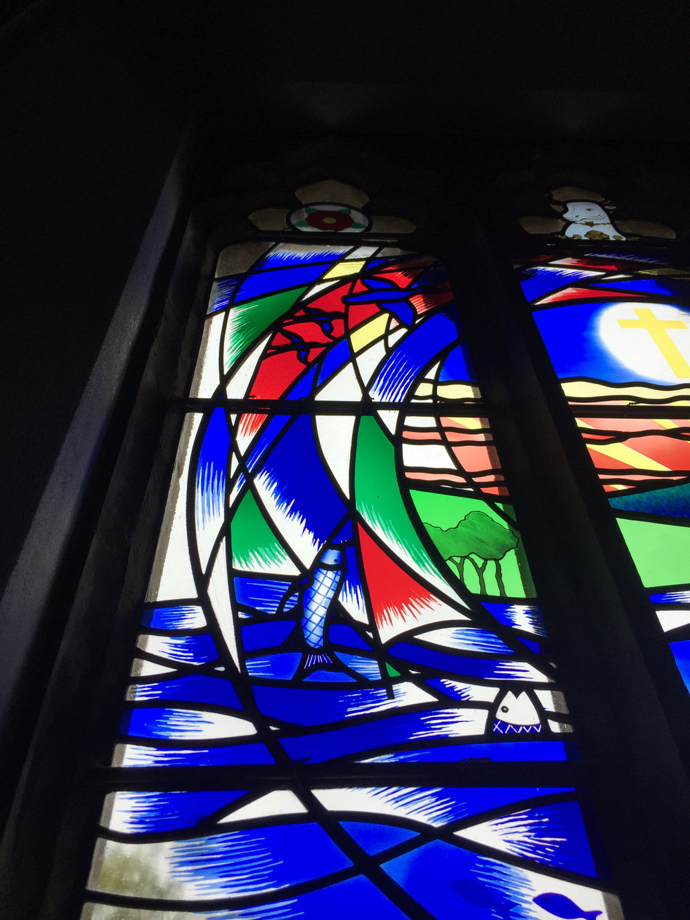 Stained glass fish and birds in Eridge Church window