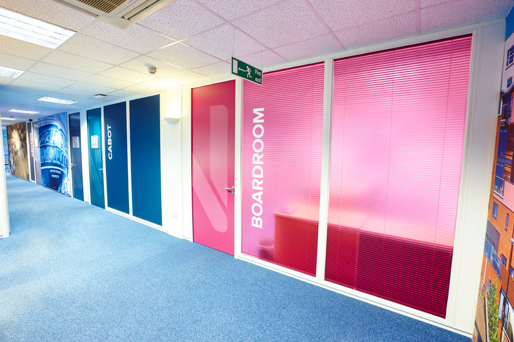 CORRIDOR AFTER  We provided branded door graphics and bold room naming on window film matching the colour palette provided in the company's new brand identity guidelines.